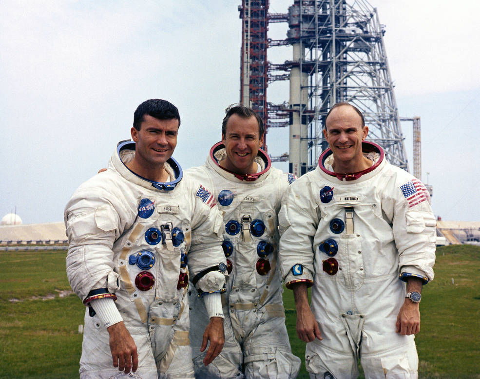 3 astronauts suited up at the launch pad