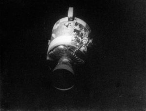 a photo of the damaged service module in space