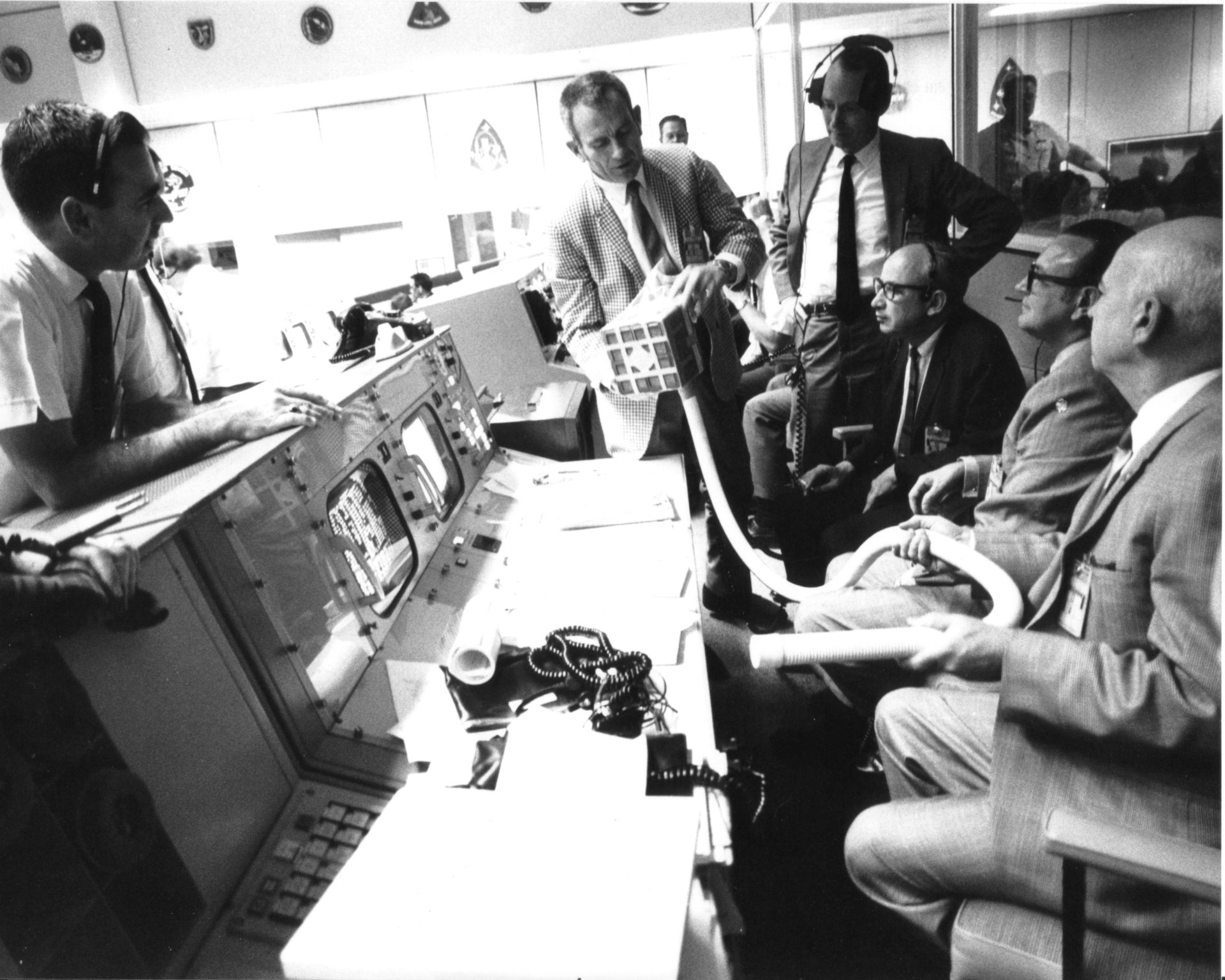 things get serious as people discuss how to repair the model partin the mission control room