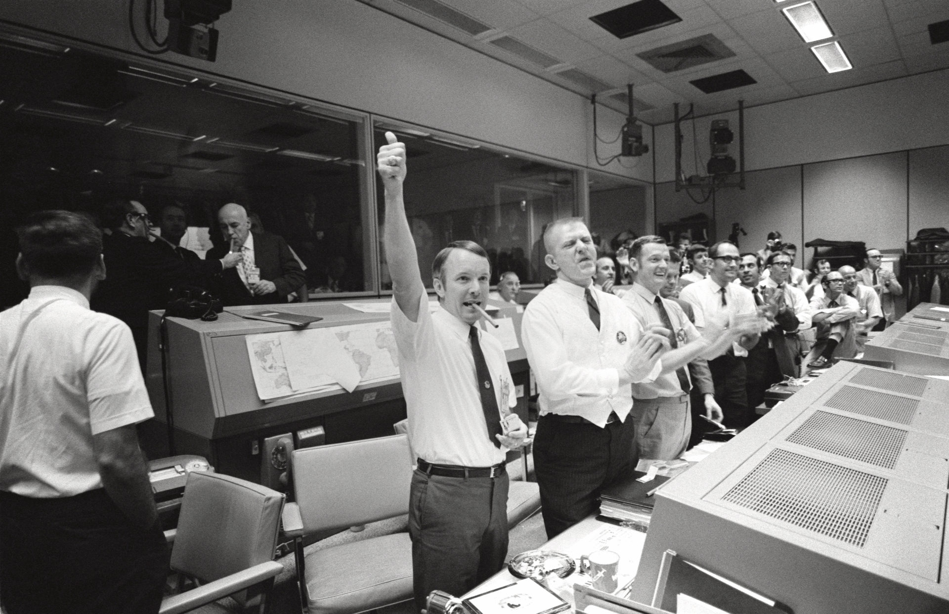 Mission control celebrates a safe return with a big thumbs up!
