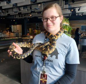 Kallie holds a snake