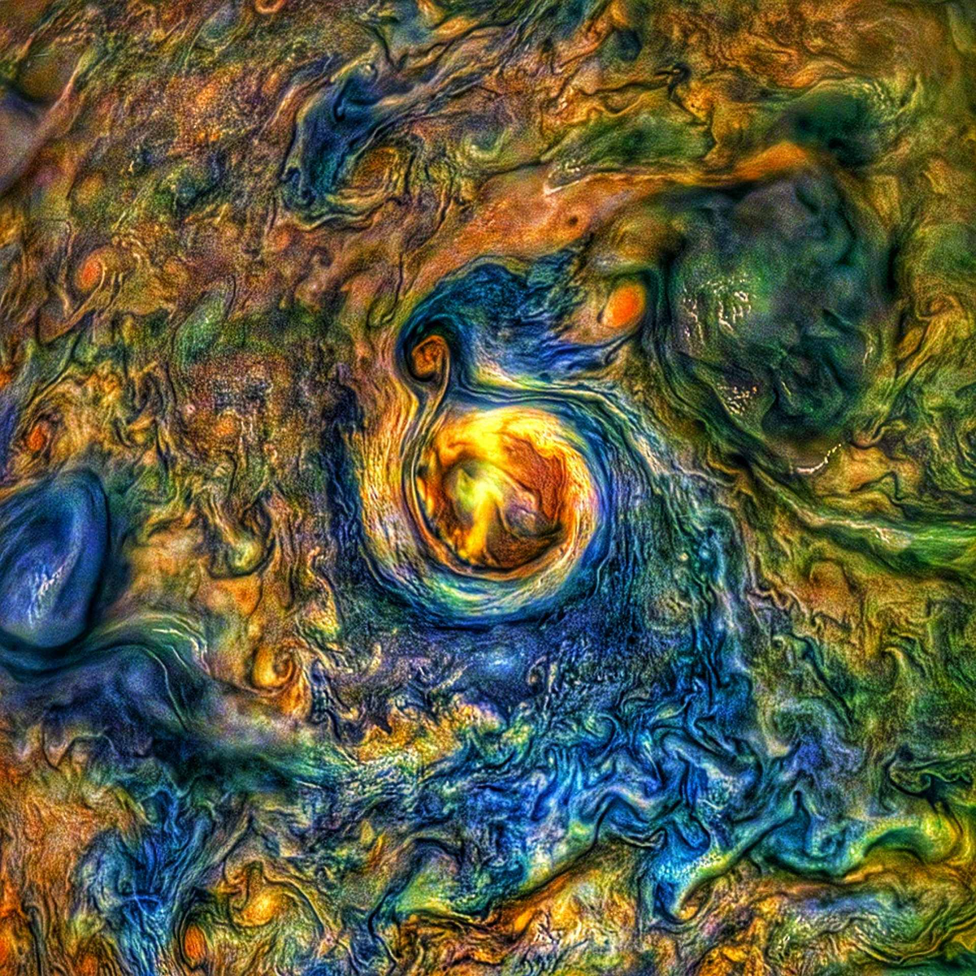 marbled image of yellow, orange, green, blue