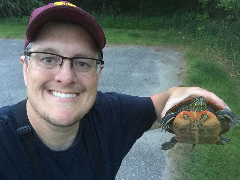 Man holding a turtle