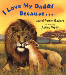 A children's book with a lion cub & father. Text:I love my daddy because... by laurel porter gaylord pictures by ashley wolff