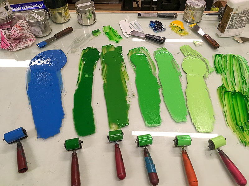 stripes of blue and green paints, rollers