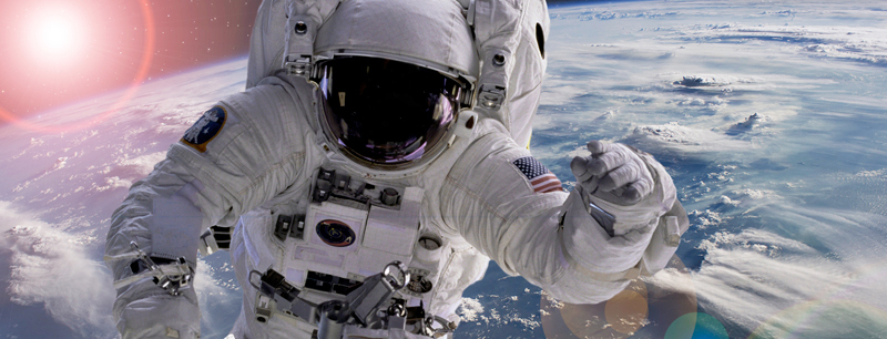 An astronaut floating with Earth in the background