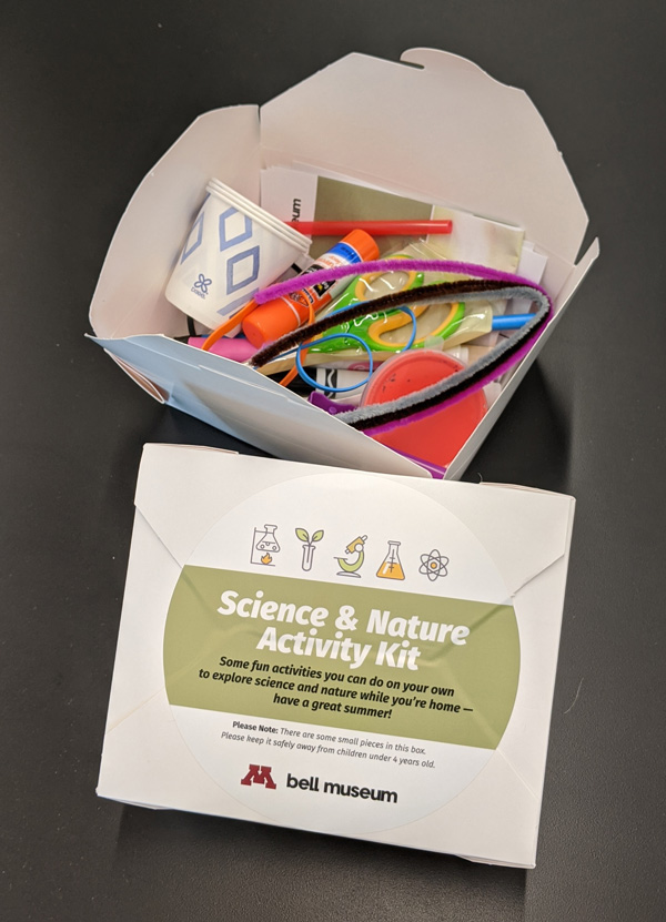 takeout box with craft items, sticker reading