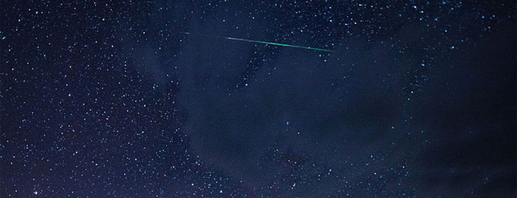 night sky with perseid meteor shower