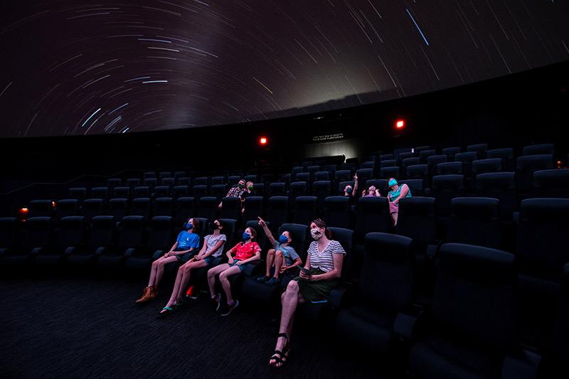 Audience in the planetarium wearing masks