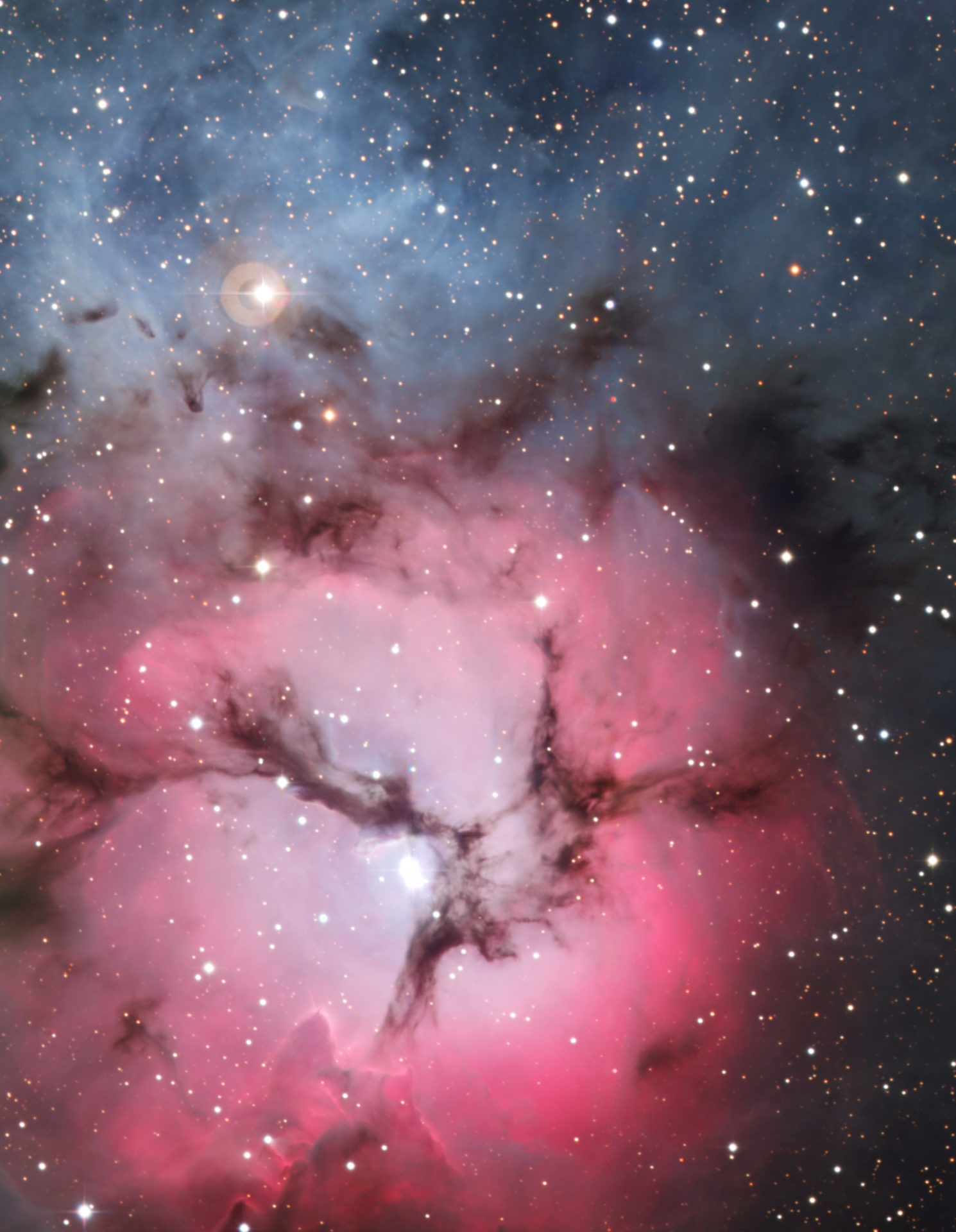 beautiful hot pink nebula with stars in a blue sky