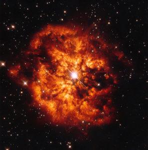 Bright, intense orange nebula in a night sky