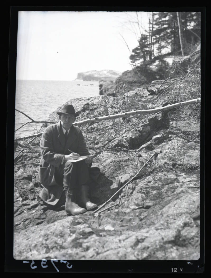 Jaques sketches at shovel point, sitting on a log
