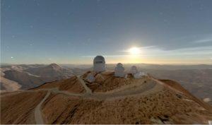 observatory on a desert hill overlooking a sunrise