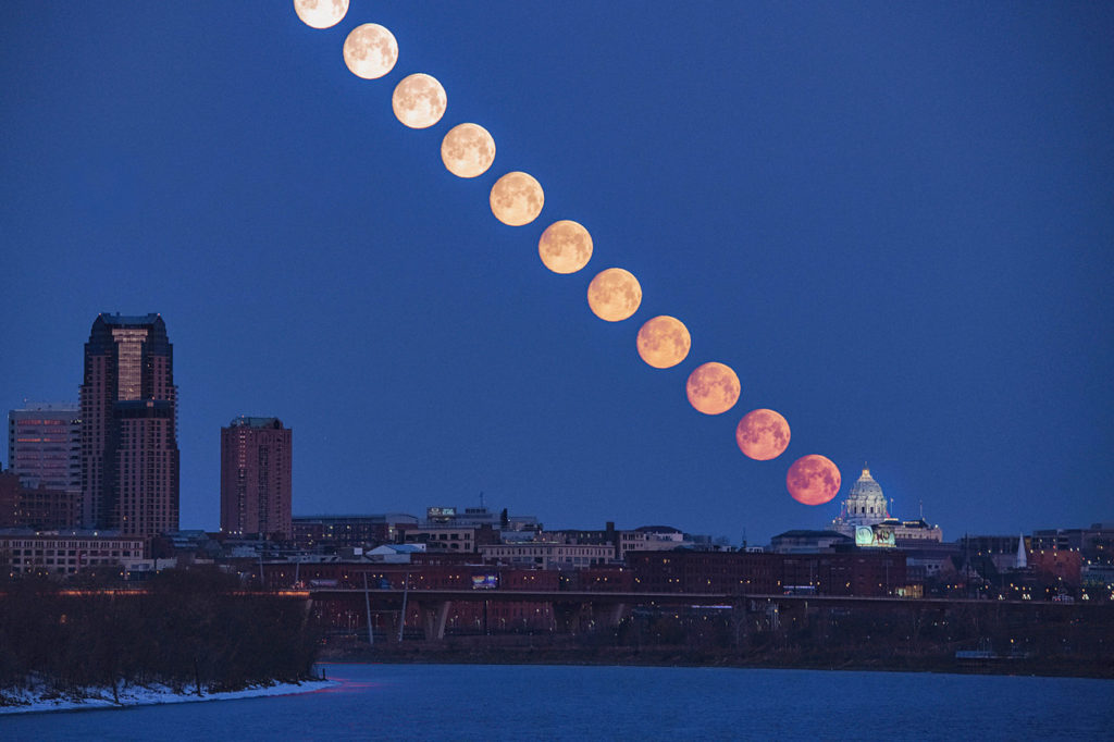 Display of images combined displaying the moon rising from the MN State Capital