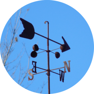 weather vane with arrow pointing west