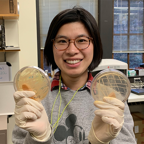 Woman holding two petri dishes