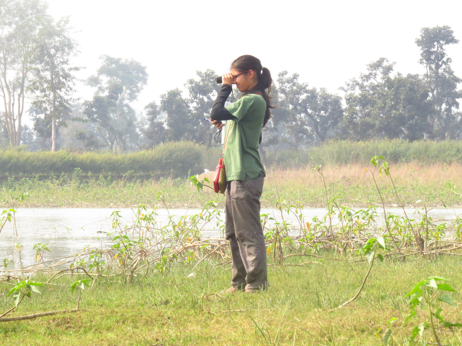 Woman standing in Gondia landscape