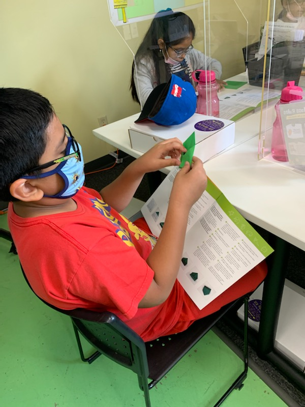 Two children working on stem kit activities