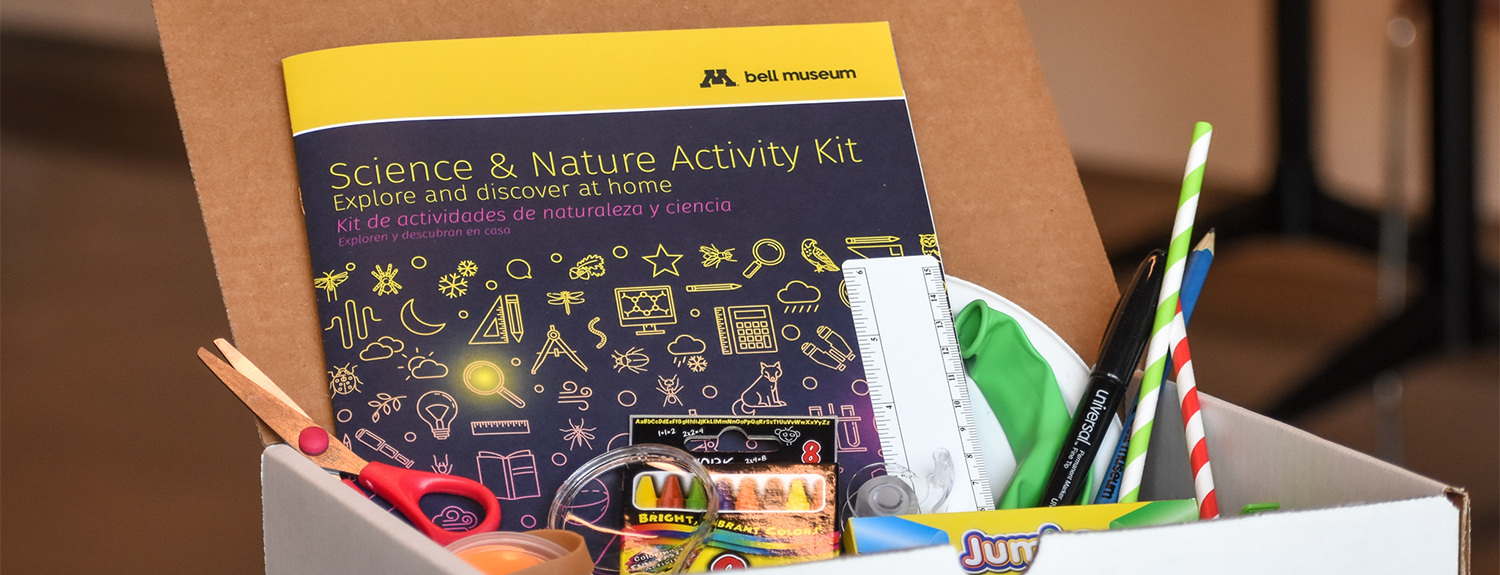 Open box of supplies with activity booklet