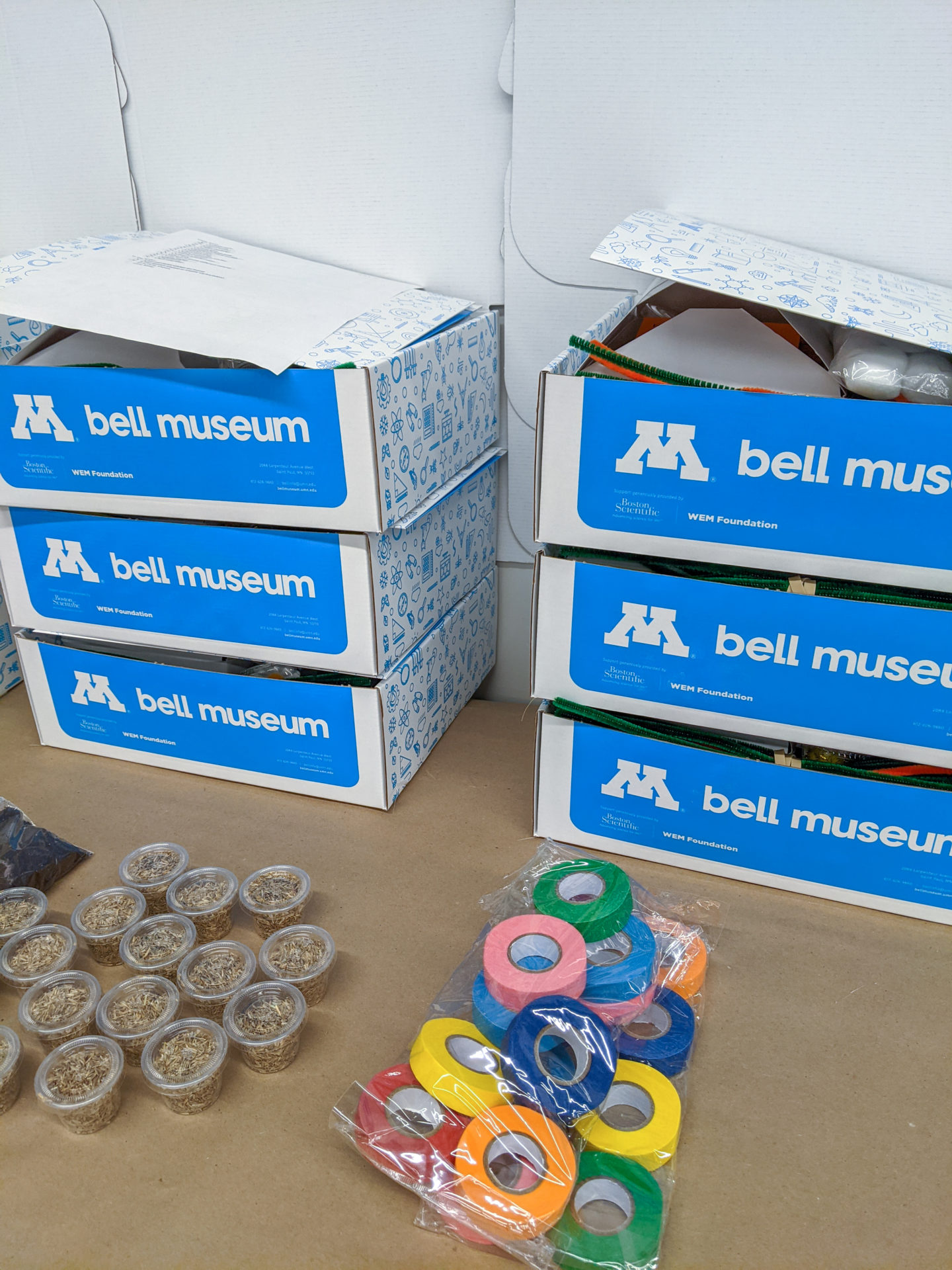 stack of six bell museum camp boxes